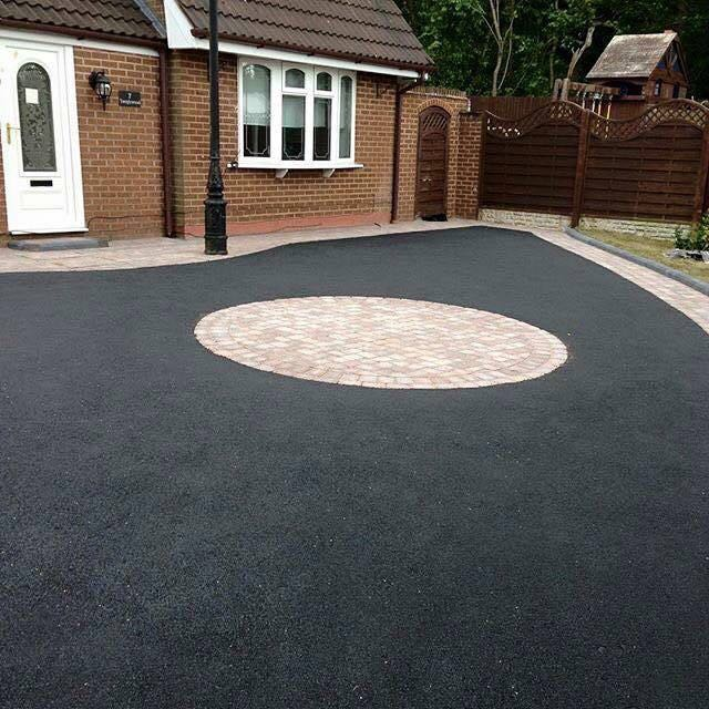 Tarmacadam with paved circle