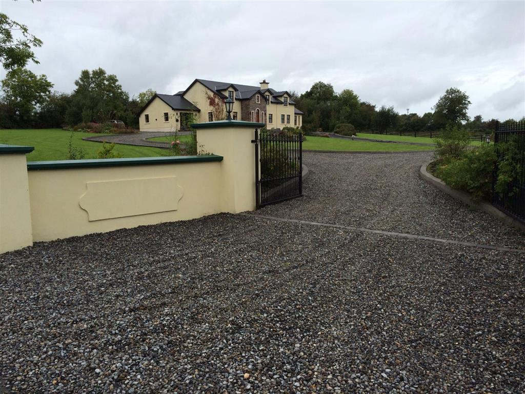 Gravel driveways cork and waterford low cost for Sloped driveway options